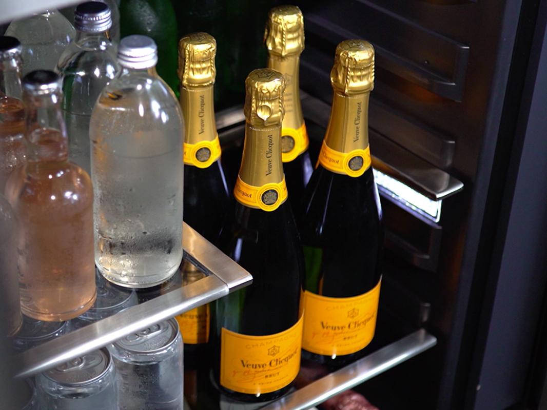 PRB24C01BS - Zephyr Presrv™ Single Zone Beverage Cooler with Retractable Quarter-Shelf showing Champagne Bottles